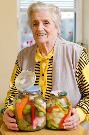 Happy old gray-haired woman with veggies photo
