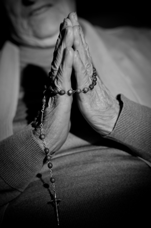 orison: a close up view of praying hands Stock Photo