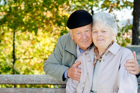 Beautiful senior couple in the park Stock Photo