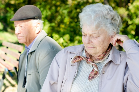 ignoring: Senior woman and her husband looking away after an argument