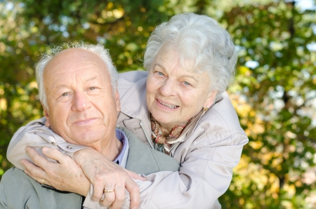Beautiful senior couple in the park photo