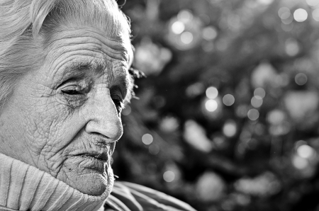 Sad old gray-haired woman