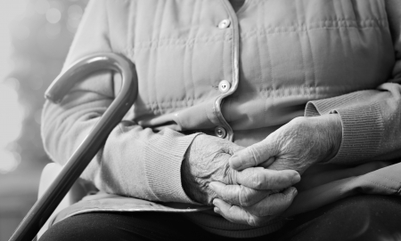 Senior woman holding her hands together Stock Photo