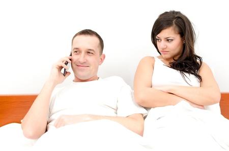 Man talking on the phone, woman upset
