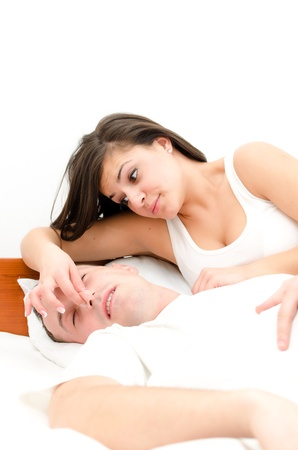 Snoring man. Couple in bed, man snoring and woman can not sleep, photo