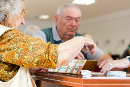 Senior people playing rummy together Stock Photo