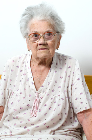 residental care: Senior woman relaxing in bed