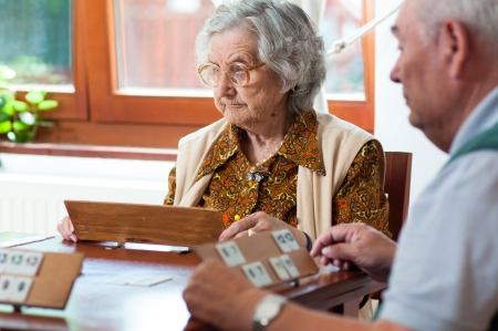 Senior people playing rummy Stock Photo