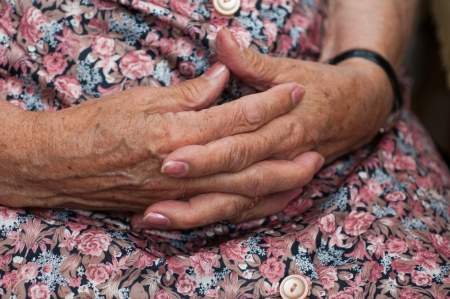 believes: Senior woman holding her hands together Stock Photo