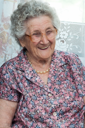 Portrait of a smiling elderly woman Stock Photo