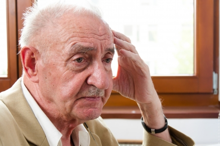 sad lonely old man sitting photo