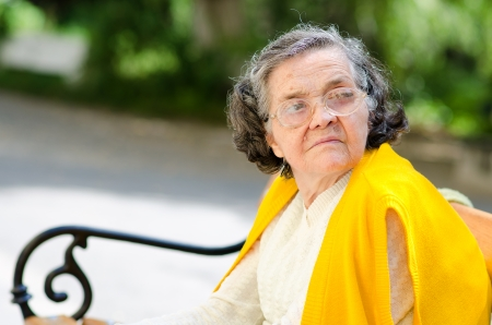 Portrait of the elderly woman. A photo on outdoors  photo