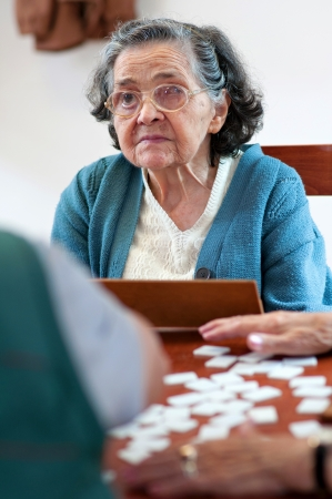 rummy: Senior people playing rummy together Stock Photo