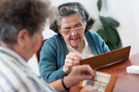 Senior people playing rummy game