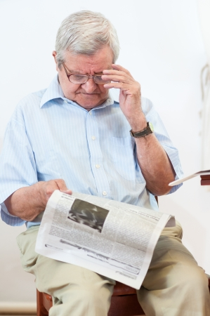 cute old man with newspaper  photo