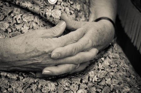 old womans hands joined together photo