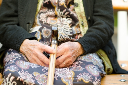 Hands of the old woman with a cane  Stock Photo