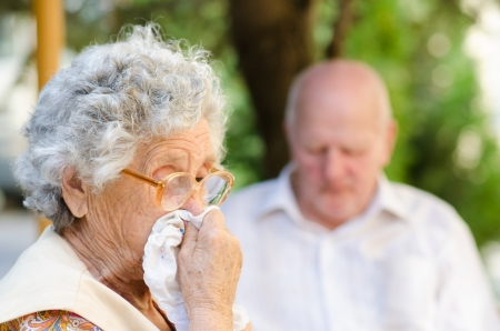 Elderly woman has flu in the nature
