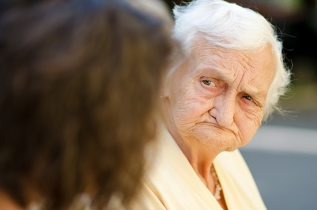 Elderly woman listening to the social worker photo