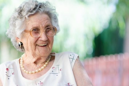 Portrait of a smiling elderly woman Stock fotó