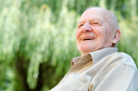 Closeup profile on a smiling old man photo