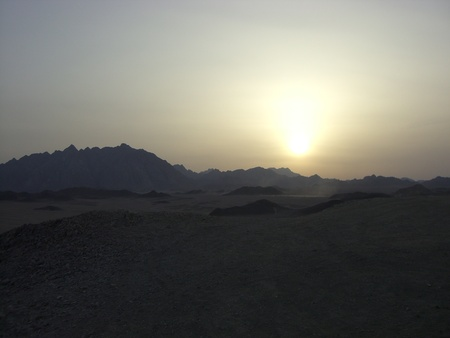sunset behind the mountains of the Egyptian desert Stock Photo