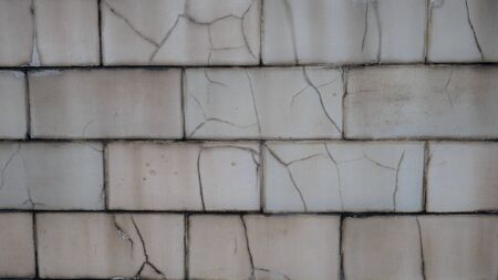 Texture of cracked white brick. Old building