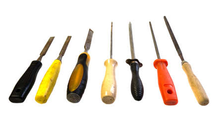 A set of different types of chisels and files. Different tools of the master. View from top, place for your text. Tools for construction, repair and woodwork.