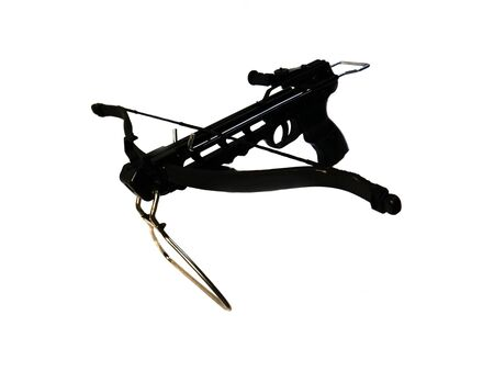Sports crossbow on a white background. Shot from a crossbow. Isolated black little crossbow. View from above. There is room for text.