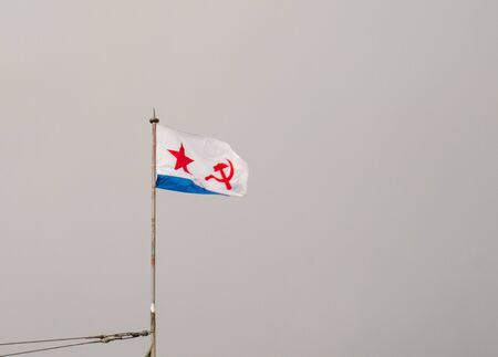 Military naval flag of the USSR. The flag is white and blue with a star and a sickle and a hammer.