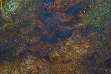 Paint or other liquid is splashed on the stone. Beautiful abstract texture.