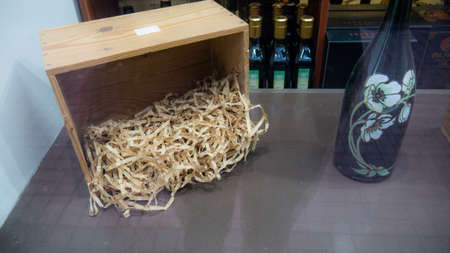 A bottle of champagne and an old box for transporting fragile goods.