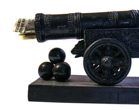 The moneys stuck in the gun. Cannon shot with money. Empty waste of money. Gun shooting kernels in miniature.