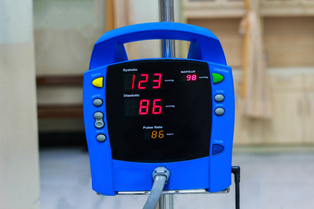 blood pressure monitor showing a normal blood pressure in the hospital Stock Photo