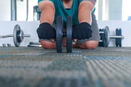 abdominal muscles: Ab roller wheel used for exercising abdominal muscles Stock Photo