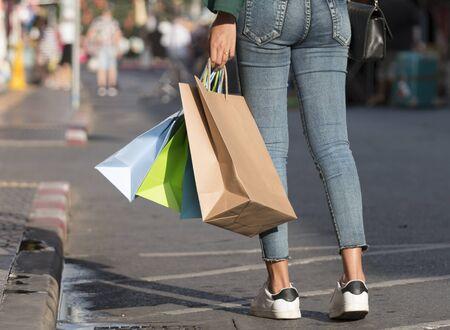 Closeup of woman holding shopping bags . 版權商用圖片