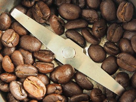 maching: Coffee bean in grinding maching Stock Photo