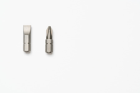 flathead: Choices: Phillips number 2 or flathead screwdriver bits on a white background Stock Photo