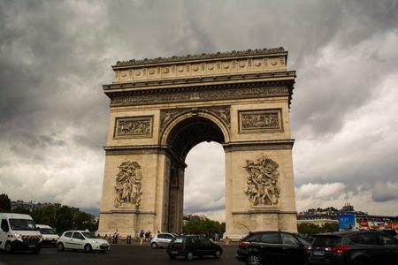 champs elysees quarter: Cars Around the Arc de Triomphe in Paris,  France