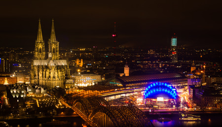 leading light: Nighttime Cologne Landscape with Bright Lights on Cathedral, TV Tower, Hohenzollern Bridge