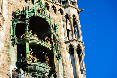 rathaus: Munich Rathaus Glockenspiel in Action on Sunny Day in Germany