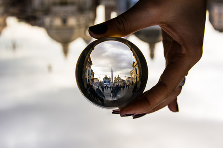 glass sphere: Piazza del Popolo in Rome, Italy with Dramatic Clouds through Glass Sphere Perspective