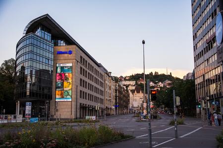 u bahn: Stuttgart City Charlottenplatz Building and Street at Sunset Editorial