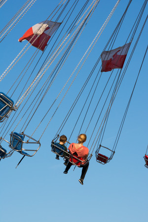 festival moments: Mother and Son Swing Ride Fair Blue Sky Festival Swinging Stock Photo