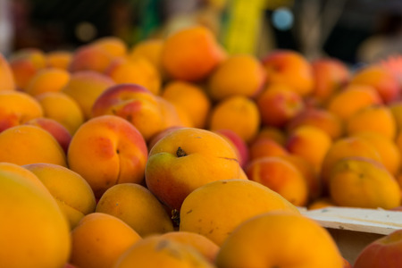 Close Up Bunch of Colorful Peaches Local Food Market Stock Photo