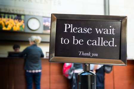 wait sign: Please Wait to be Called Sign Caution Line Thank You Stock Photo