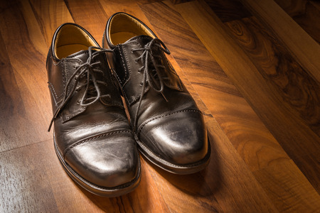 Black Leather Dress Shoes Worn Wooden Floor Sunlight Spotlight Sheen Elegenat Business Casual