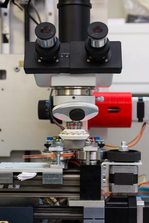 examine: Microscope Camera Device Print Examine Industry Quality Machine Tool White Stock Photo