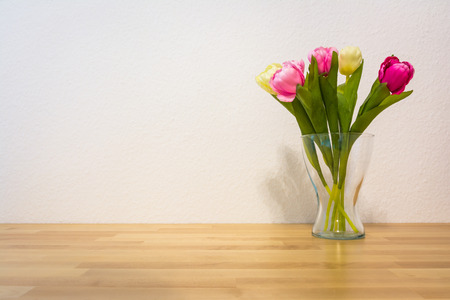 Pink Yellow Tulips Wooden Table White Wall Glass Vase Stock Photo