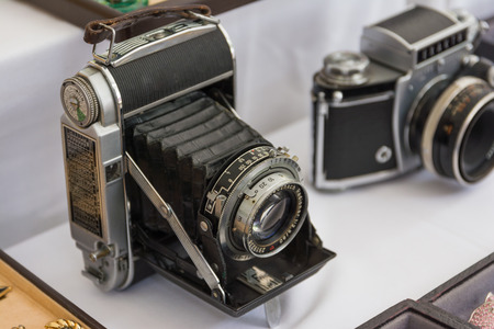 Old Vintage Camera Metal Frame Black Grip Photography Equipment White Table Stock Photo
